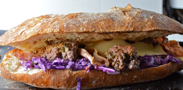 Meatball Sandwich With Red Cabbage Slaw, Cheese, And Pancetta